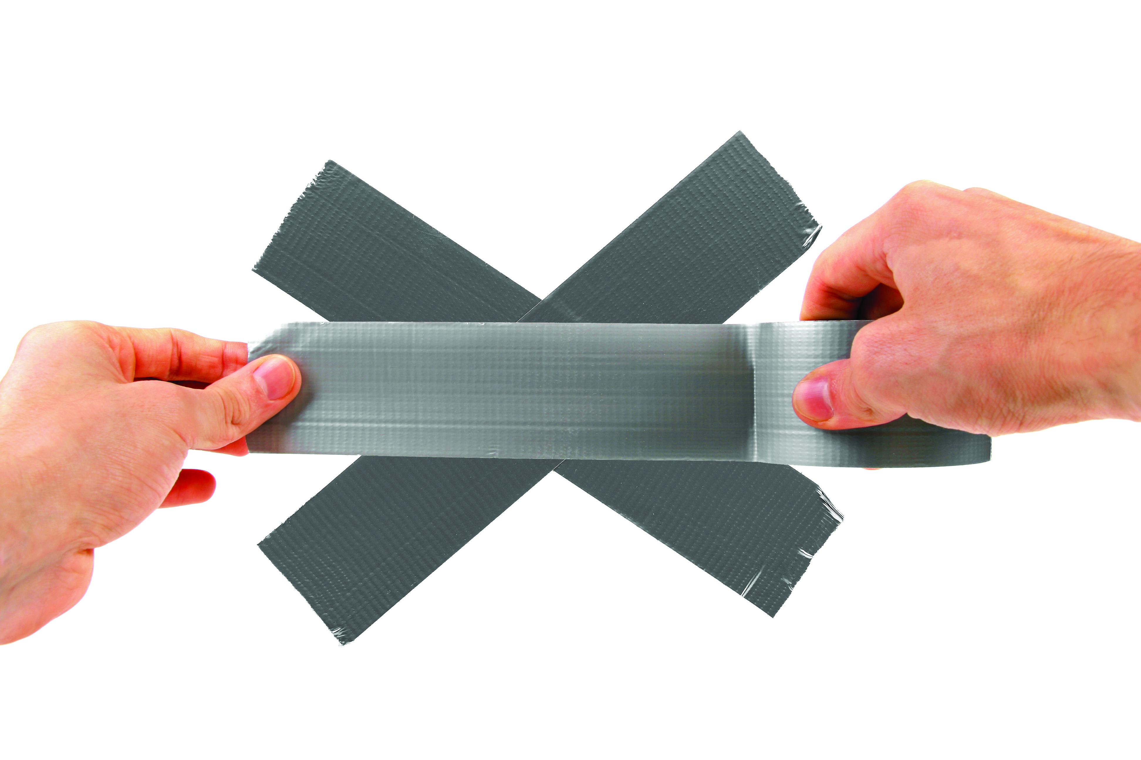 Hands applying duct tape to a white surface